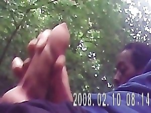 exhib wank and sucking a black guy in the forest